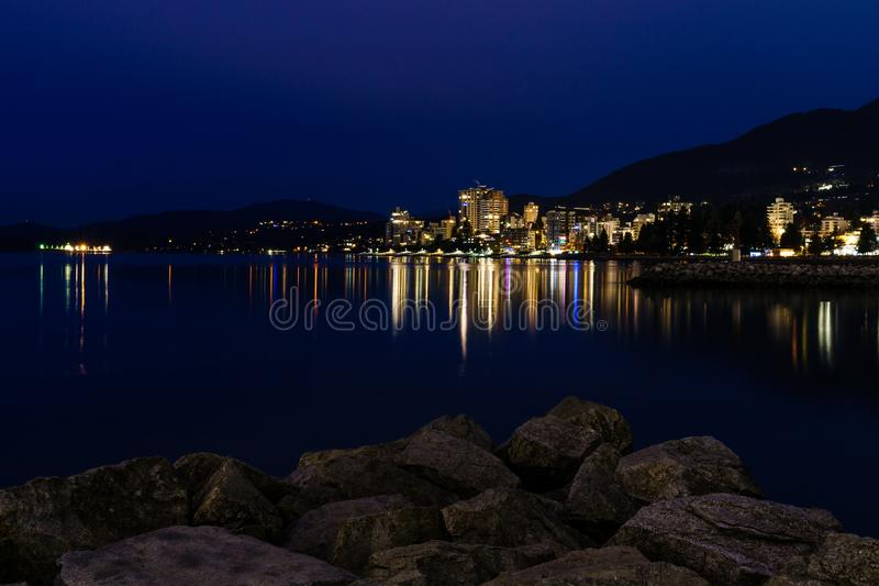 west vancouver night scene with reflection in Burrard Inlet stock images