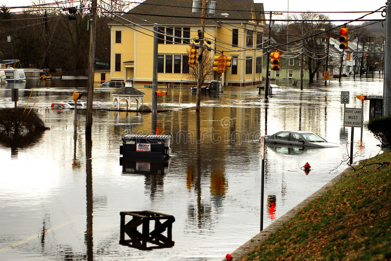 West Warwick Rhode Island devastated by floods. The Town of West Warwick, Rhode Island is devastated by flooding that caused the nearby Pawtuxet River to royalty free stock image