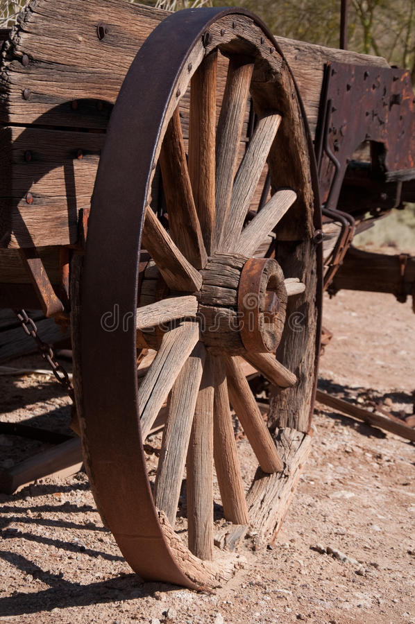 West Wheel. Wild west coach wheel in ghost town stock photo