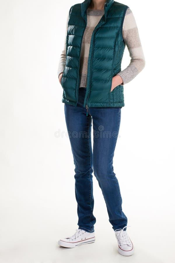 Weste, Jeans und Gummiüberschuhe lizenzfreie stockfotos