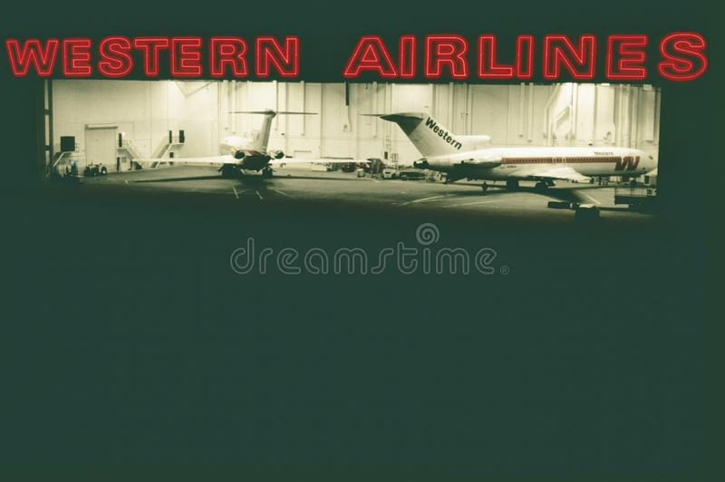 Western Airlines Los Angeles International hangar. Western Airlines Los Angeles International Airport hangar . Two Boeing B-727 aircraft are inside stock images