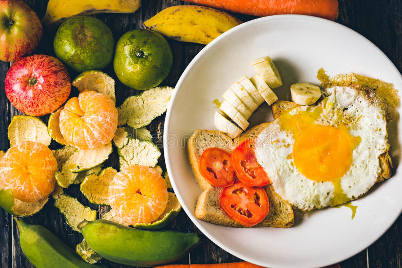 Western breakfast : toast egg and fruit royalty free stock images