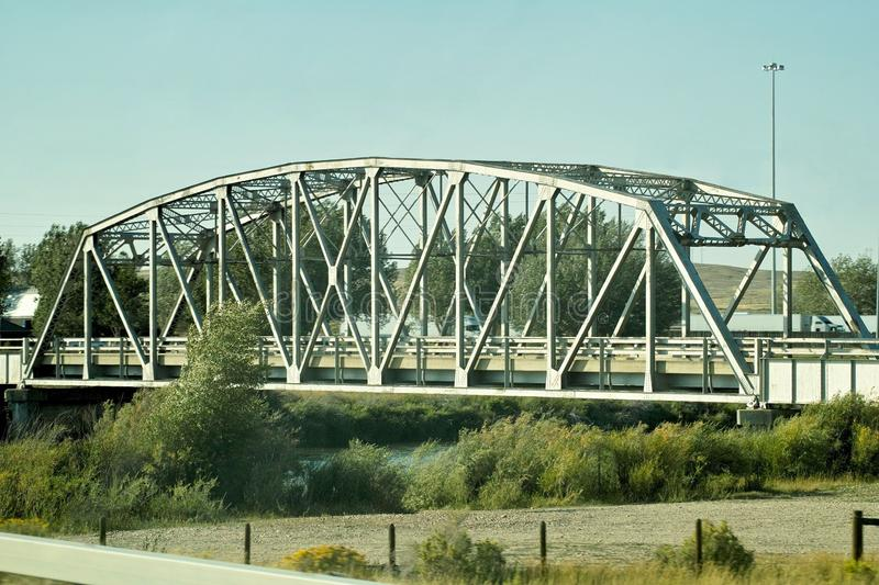 Western Bridge. A steel bridge holding a road over a western river royalty free stock photos