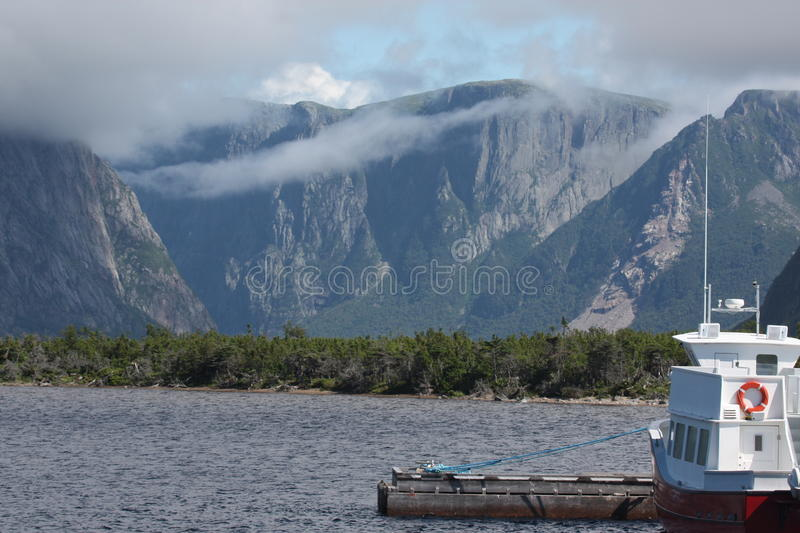 Western Brook Pond, Newfoundland. Fog clears in the morning at Western Brook Pond, Gros Morne National Park, Newfoundland, Canada royalty free stock images