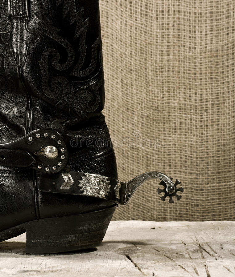 Western cowboy boot with spur royalty free stock image