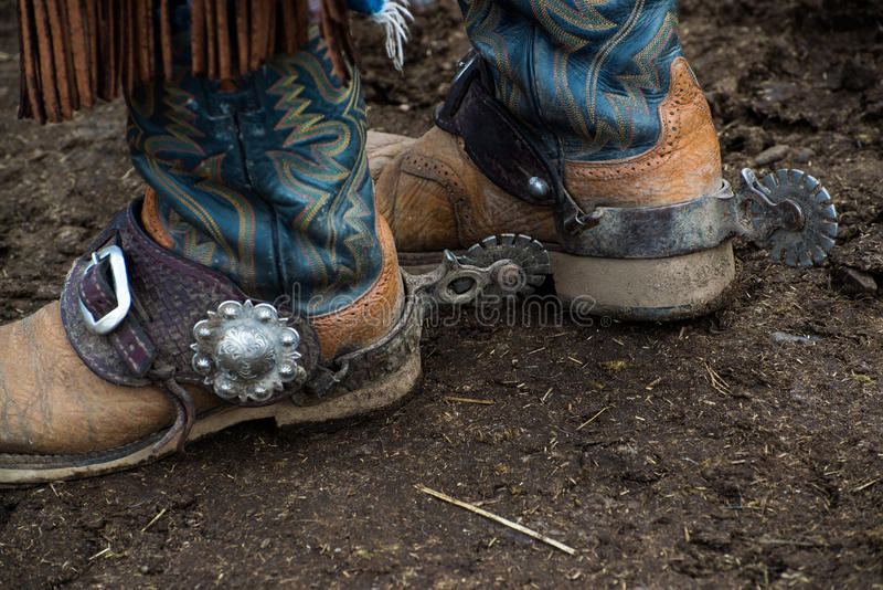Western cowboy boots and silver spurs stock images
