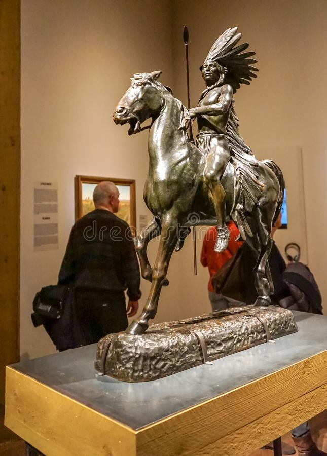 Western culture at Montreal Museum. For Montreal Museum of Fine arts exhibition named Western, bronze sculpture named Indian Warrior realized in 1922 by royalty free stock images