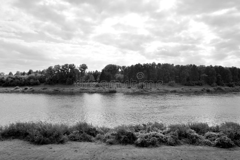 Western Dvina river. At cloud summer day in Polotsk, Belarus. Black and white stock photo