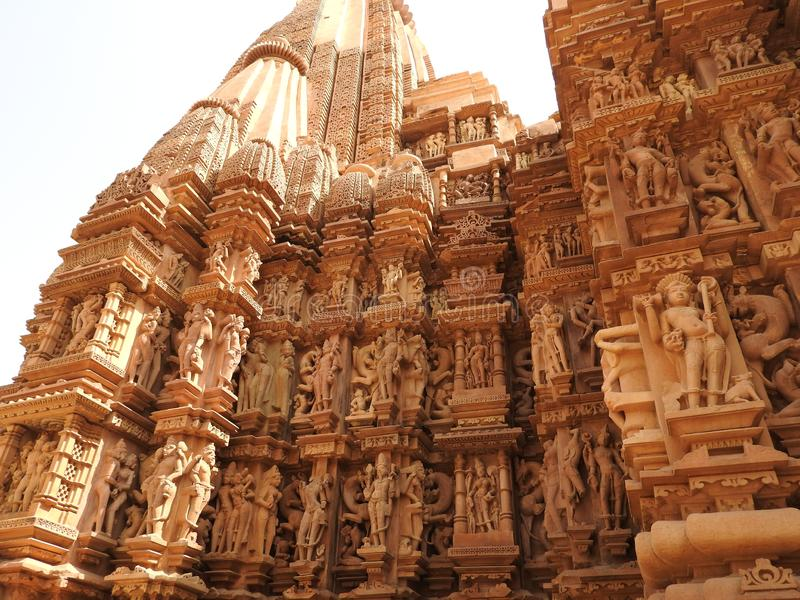 The Western group of Khajuraho temples, a UNESCO heritage site, is famous for its erotic sculptures, India, clear day.  stock images