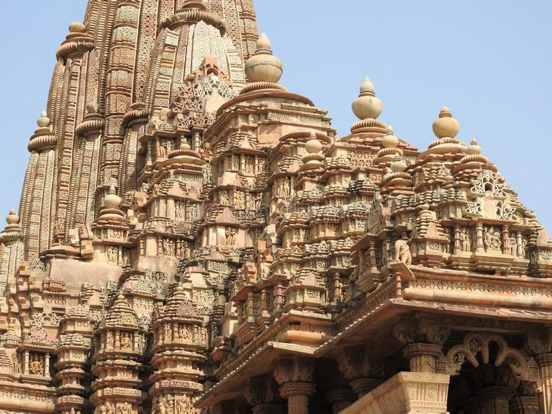 The Western group of Khajuraho temples, a UNESCO heritage site, is famous for its sexy erotic sculptures, India, clear day.  stock images