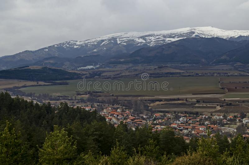 Western  part of the Zlatitsa Pirdop valley and residential district of  village Chavdar in background of the snowy Balkan. Mountain, Sofia, Bulgaria, Europe royalty free stock image