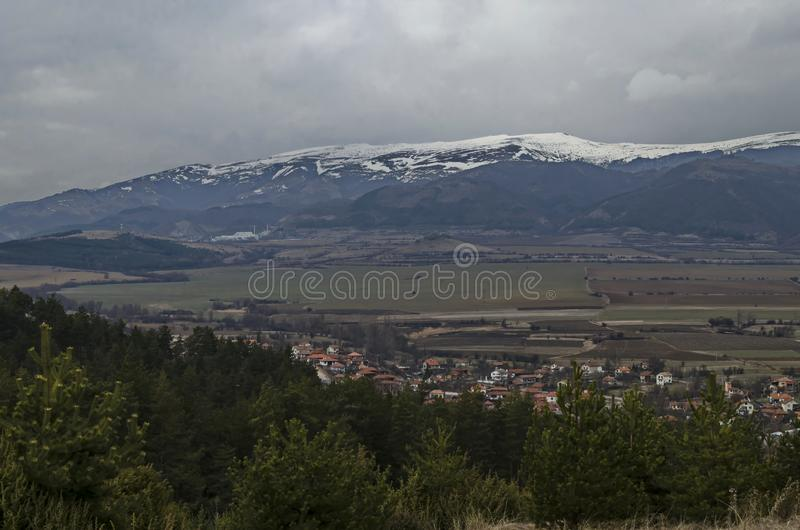 Western  part of the Zlatitsa Pirdop valley and residential district of  village Chavdar in background of the snowy Balkan. Mountain, Sofia, Bulgaria, Europe royalty free stock images