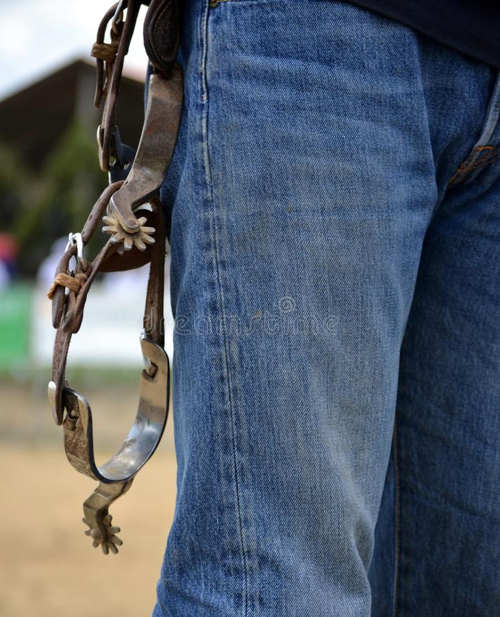 Western riding spurs hanging on belt stock images