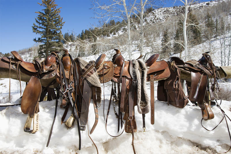 Western Saddles On A Rail Royalty Free Stock Photography