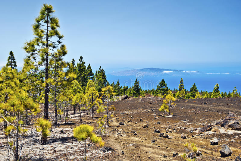 Western slopes of Teide national Park to the Ocean. Volcanic landscape of Western slopes of Teide national Park Via Atlantic Ocean and La Gomera and El Hierro royalty free stock photography