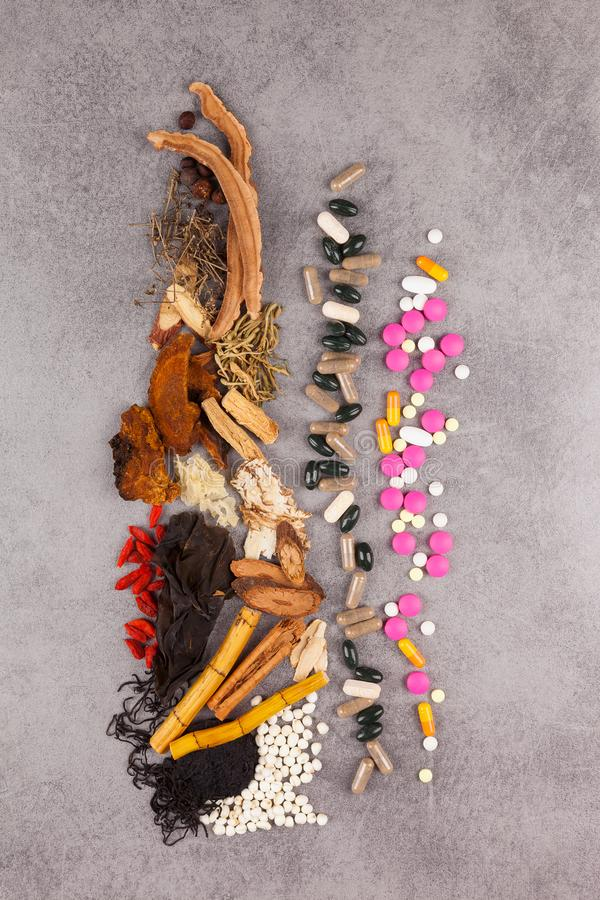 Western and traditional chinese medicine background. Different kind of Chinese herbal and western medicine background from above royalty free stock photography