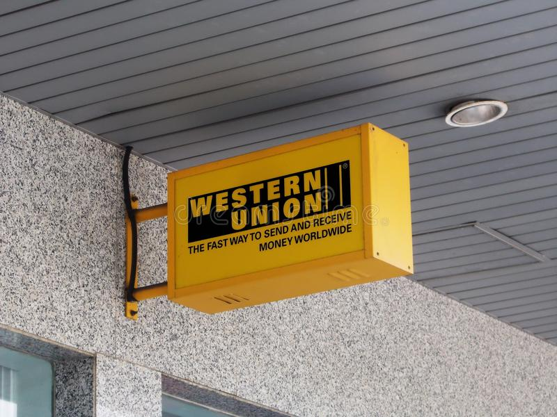Western Union Electric Signboard. A Western Union electric signboard in Malaysia. Picture was taken at one of the many branches of Public Bank, an agent for stock images