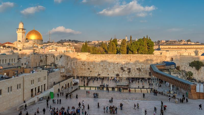 Western Wall in Jerusalem Old City, Israel. A view of Temple Mount in the old city of Jerusalem, including the Western Wall and golden Dome of the Rock, packed royalty free stock image