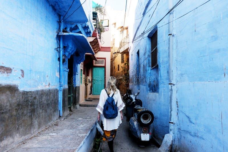 Western woman exploring the blue city, Jodhpur India royalty free stock images