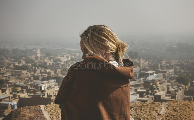 Western woman exploring Jaisalmer Fort, Rajasthan, India royalty free stock photos