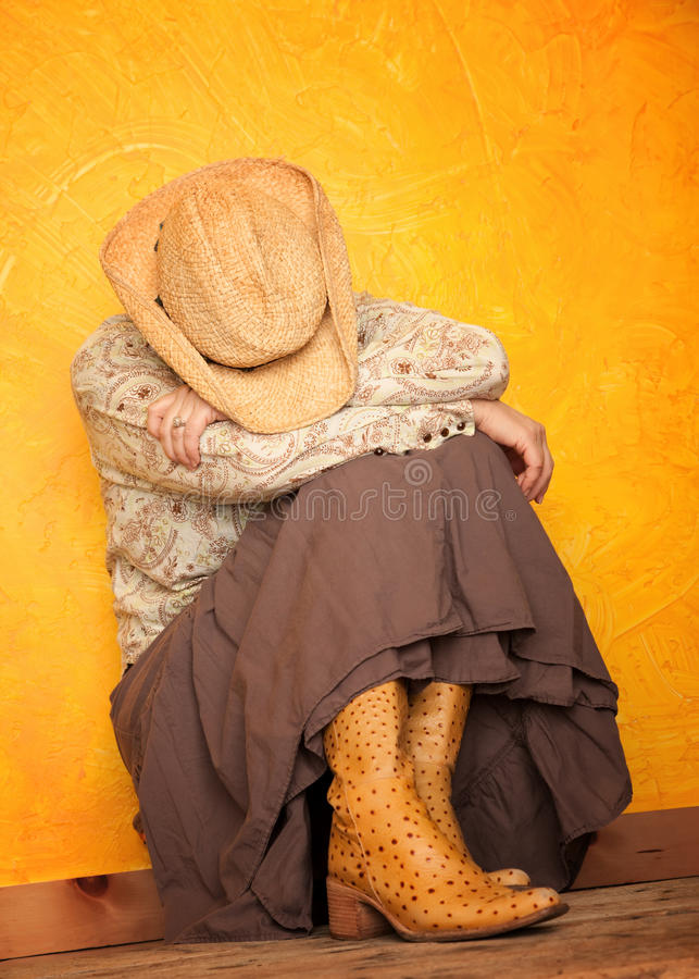 Download Western Woman With Her Head Down Stock Photo - Image: 15996610