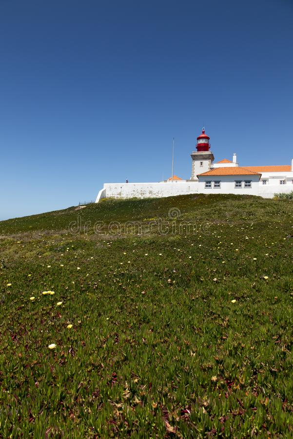 The westernmost lighthouse of Cabo da Roca in Porugalia with the yellow-flowered Hottentot fig growing. In Europe stock images