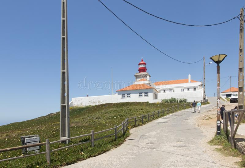 The westernmost lighthouse of Cabo da Roca in Porugalia with the yellow-flowered Hottentot fig growing. In Europe royalty free stock photography