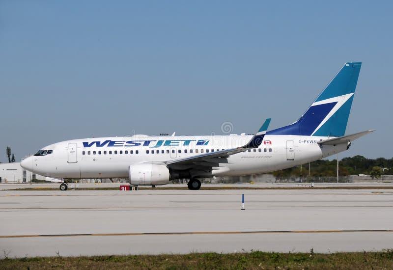 westjet пассажира самолета стоковое фото