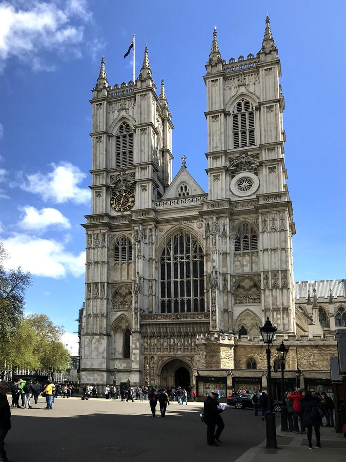 Westminster Abbey on a sunny day. Westminster Abbey - the cathedral church of St. Peter on a sunny day with tourist stock images