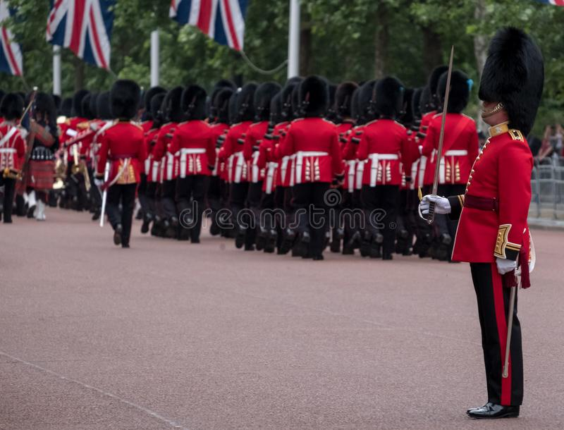Soldiers marching down The Mall in London during the Trooping the Colour military ceremony, London. Westminster London UK. Soldiers with rifles and bayonets royalty free stock photography