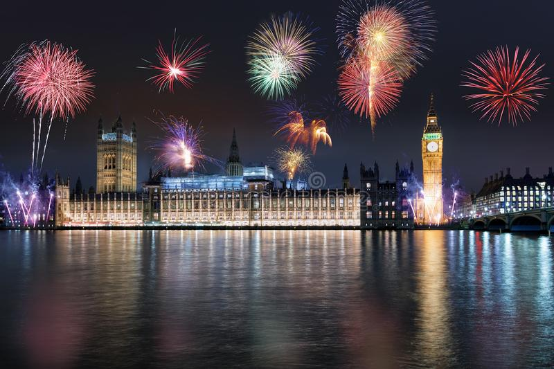 The Westminster Palace and Big ben tower during night with fireworks. The Westminster Palace and Big ben tower in London, United Kingdom, during night with royalty free stock photos