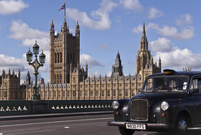 Westminster Palace and London cab. Fragment of Westminster Palace taken on August 23, 2010 in London Westminster Bridge stock photo