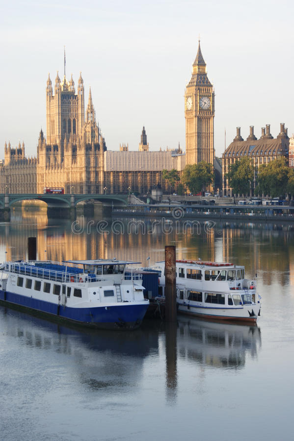 Westminster and the Thames. Westminster and boats on the Thames stock photography