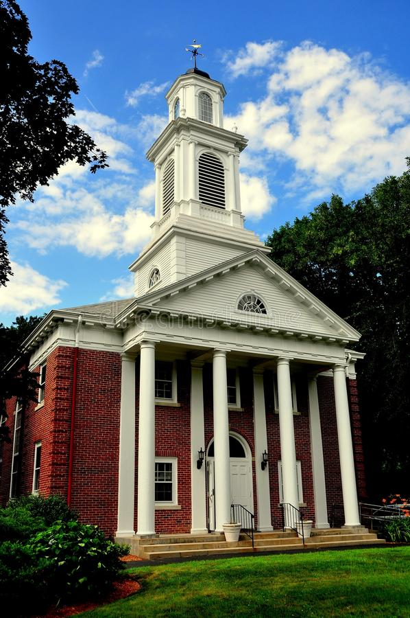 Weston, MA: First Baptist Church. Weston, Massachusetts - July 14, 2013: Colonial-style First Baptist Church with columned portico and steeple topped with a stock image