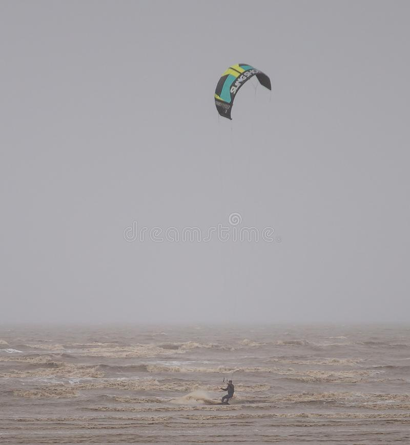 Weston Super Mare Kitesurfing. Kitesurfing in January 2019 in Weston Super Mare, United Kingdom. Waves on sea royalty free stock photography