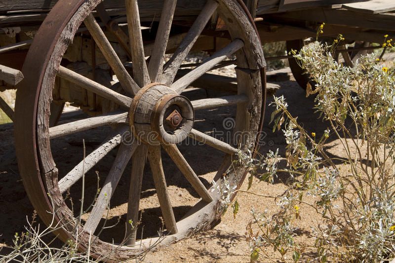 Westward Ho Old Wild West Cowboy Wagon Wheel. Wheel of a rugged old wild west stage coach wagon in central Arizona, USA stock image
