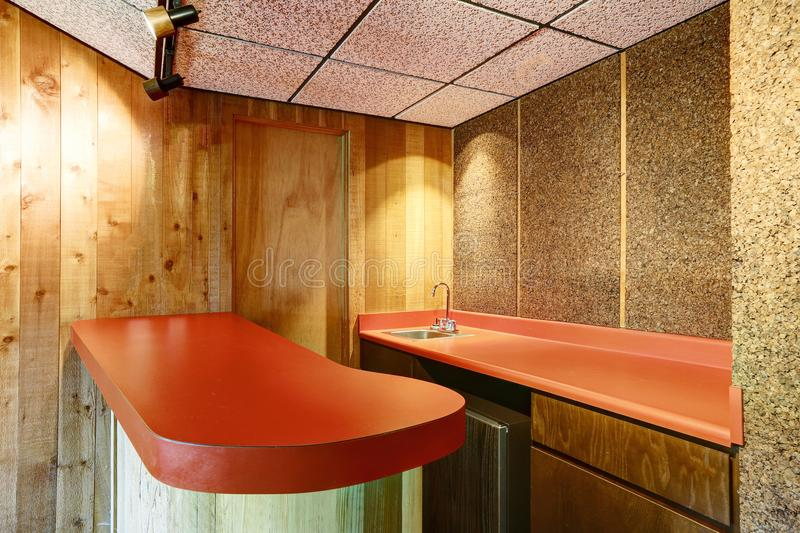 Wet bar nook with red counters and wood walls. Wet bar nook with red counters and wood plank wall. Northwest, USA royalty free stock photos
