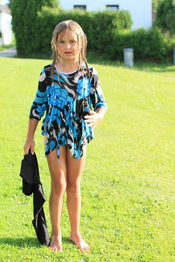 Wet barefoot girl royalty free stock photos