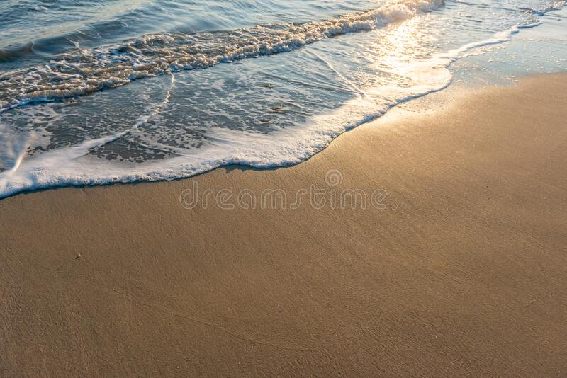 Wet beach sand and ocean. Tide royalty free stock photo