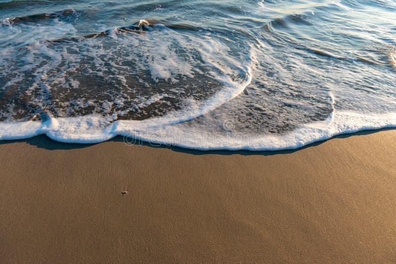Wet beach sand and ocean. Tide stock photos