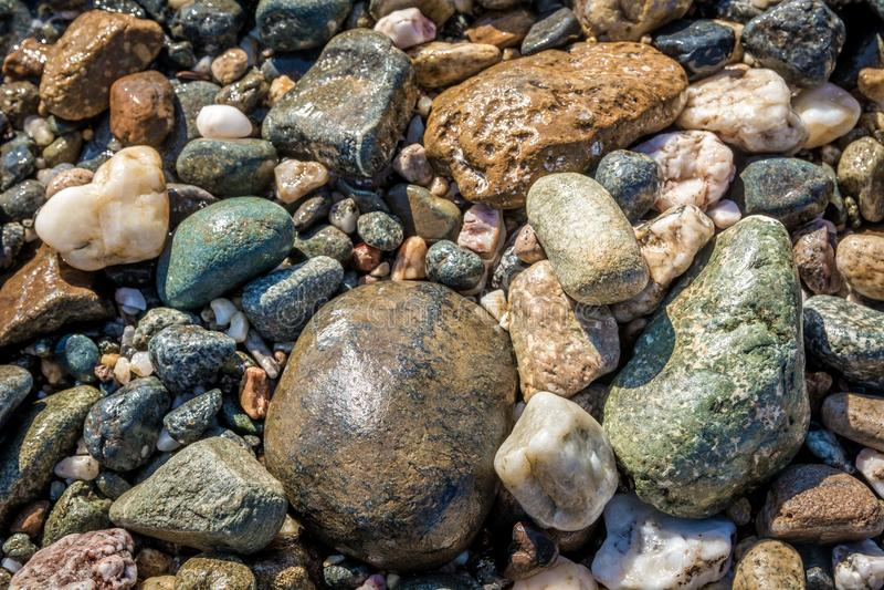Colorful round sea pebbles stock photos
