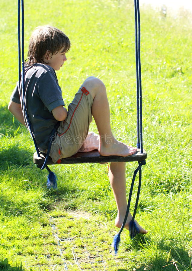 Download Wet boy on a swing stock photo. Image of play, barefooted - 25305956