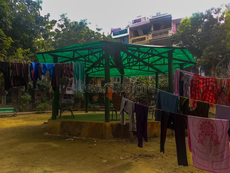 Wet clothes are placed on the rope inside the park in Delhi India royalty free stock photo