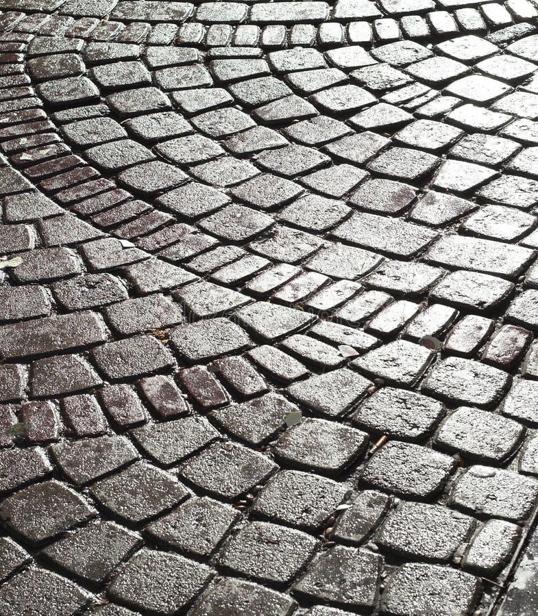 Wet cobble stone stock images