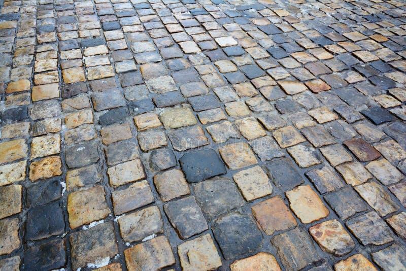 Wet cobbles. Paving stone. stock images