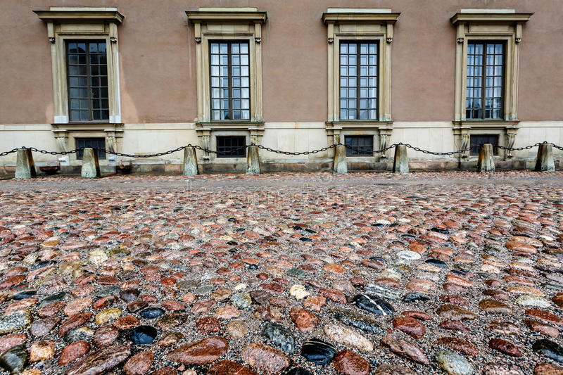 Wet Cobblestone and King Palace Facade in Gamla Stan (Old Town) stock photos