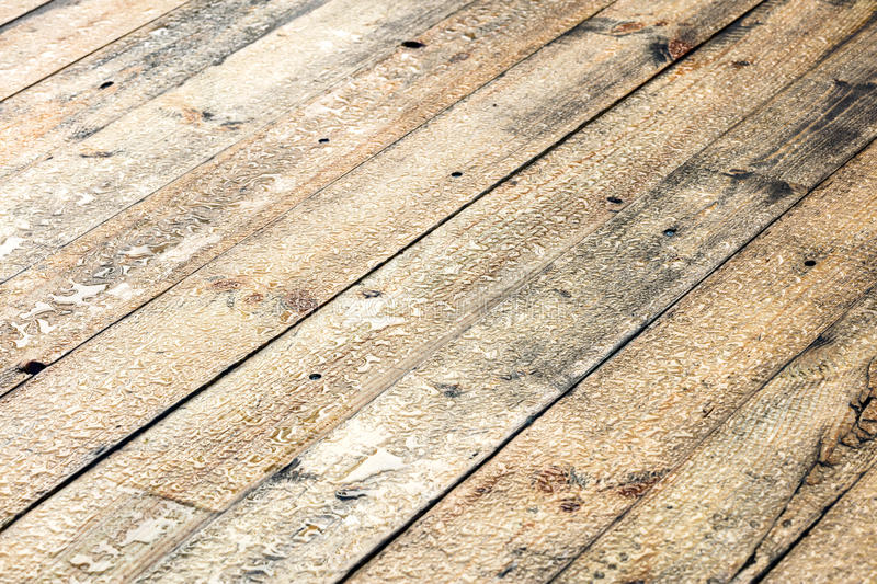 Wet cottage deck after rain. raindrops on wooden planks. royalty free stock photo