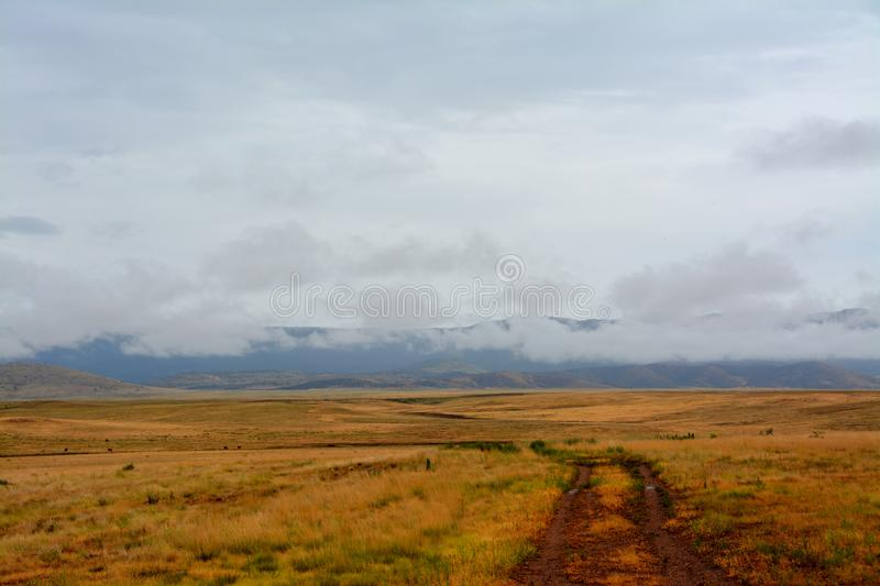 A wet dirt road leads into the Prescott Valley Landscape royalty free stock photography