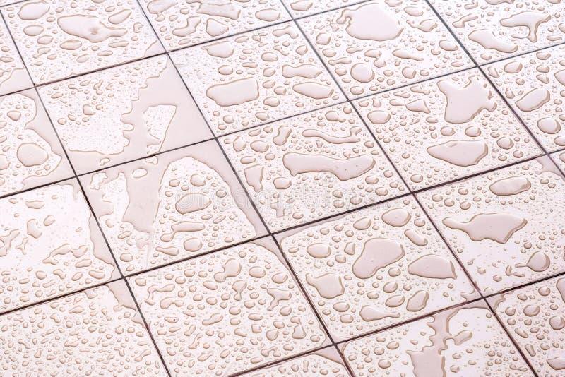 Wet Floor Square Tile stock photo