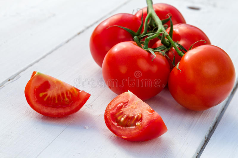 Wet fresh tomatoes for a healthy salad stock photos